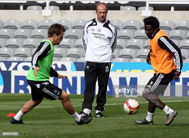 Manager Alan Shearer watches Michael Owen and Obafemi Martins during the Newcastle United open day team training session at St James' Park on April...