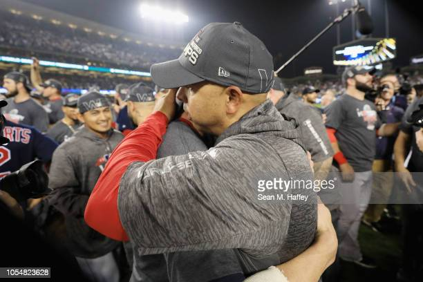 Manager Alex Cora and David Price of the Boston Red Sox celebrate their teams 51 win over the Los Angeles Dodgers in Game Five of the 2018 World...
