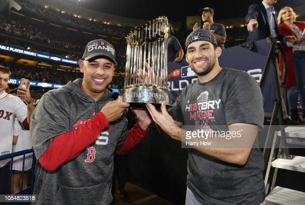 Manager Alex Cora and Nathan Eovaldi of the Boston Red Sox celebrate with the World Series trophy after their teams 51 win over the Los Angeles...