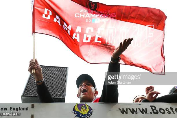 Manager Alex Cora of the Boston Red Sox acknowledges fans during the 2018 World Series victory parade on October 31 2018 in Boston Massachusetts