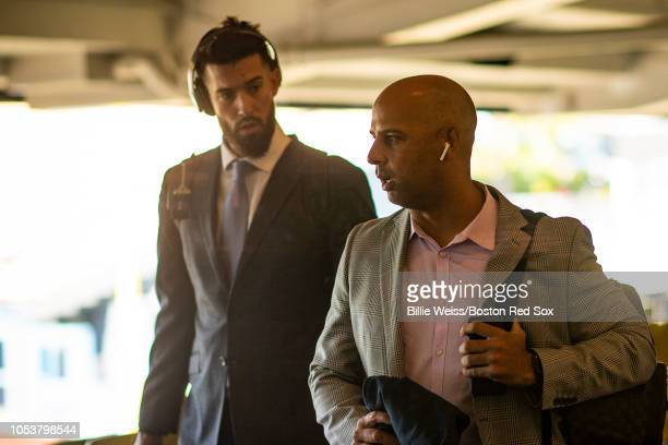 Manager Alex Cora of the Boston Red Sox and Rick Porcello talk as they arrive at Dodger Stadium before game three of the 2018 World Series against...