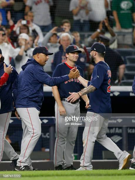 Manager Alex Cora of the Boston Red Sox celebrates with Blake Swihart after defeating the New York Yankees at Yankee Stadium on September 20 2018 in...