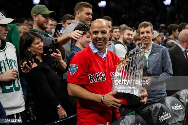 Manager Alex Cora of the Boston Red Sox celebrates with The Commissioner's Trophy during the first quarter of the game between the Boston Celtics and...