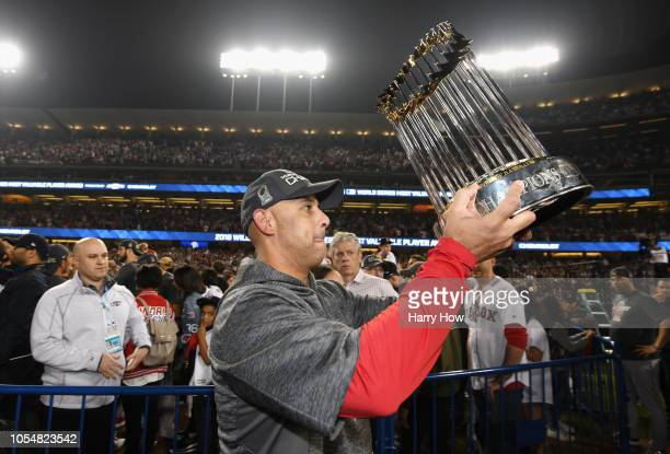 Manager Alex Cora of the Boston Red Sox celebrates with the World Series trophy after his team's 51 win over the Los Angeles Dodgers in Game Five of...