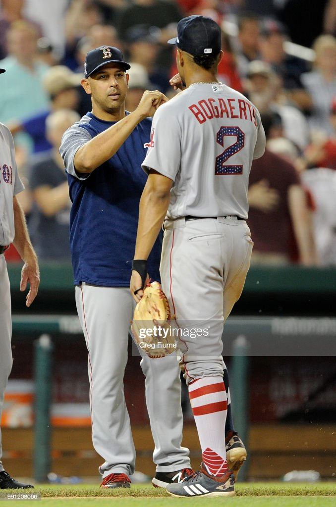 Manager Alex Cora #20 of the Boston Red Sox celebrates with Xander Bogaerts #2 after a 11-4 victory against the Washington Nationals at Nationals Park on July 3, 2018 in Washington, DC.
