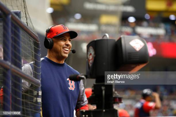Manager Alex Cora of the Boston Red Sox gives an onfield interview during the third inning of a game against the Tampa Bay Rays on August 26 2018 at...