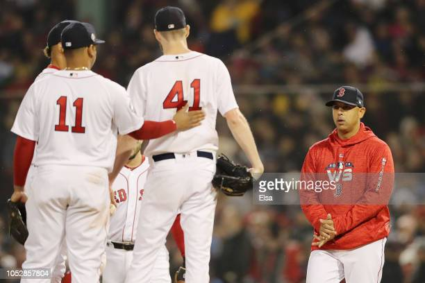 Manager Alex Cora of the Boston Red Sox goes to the mound to take Chris Sale out of the game during the fifth inning against the Los Angeles Dodgers...