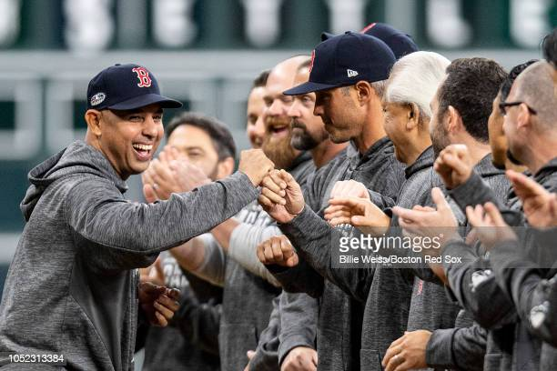 Manager Alex Cora of the Boston Red Sox high fives teammates as he is introduced before game three of the American League Championship Series against...