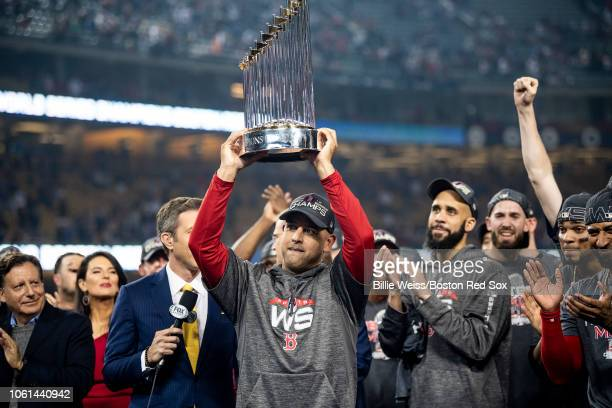 Manager Alex Cora of the Boston Red Sox holds up the World Series trophy after winning the 2018 World Series in game five against the Los Angeles...