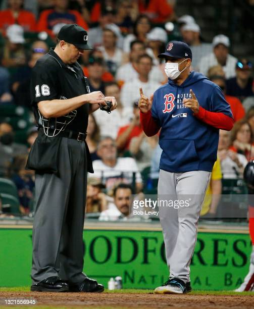 Manager Alex Cora of the Boston Red Sox is ejected by home plate umpire Lance Barrett in the sixth inning for arguing balls and strikes against the...