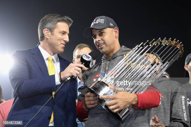 Manager Alex Cora of the Boston Red Sox is interviewed with the World Series trophy after his team's 51 win over the Los Angeles Dodgers in Game Five...