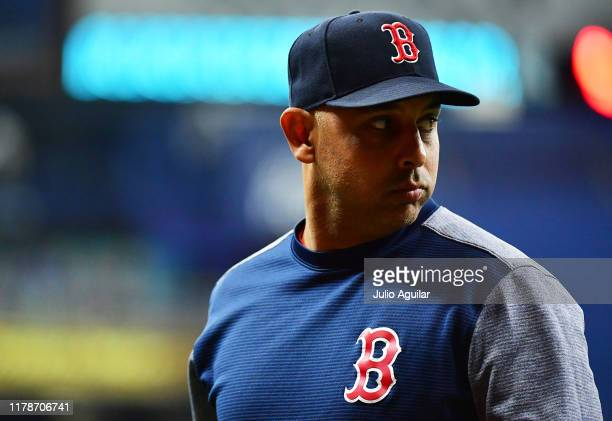 Manager Alex Cora of the Boston Red Sox looks back after relieving a pitcher against the Tampa Bay Rays at Tropicana Field on September 20 2019 in St...