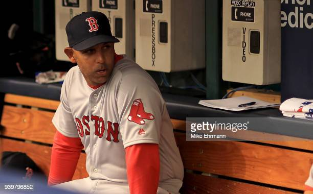 Manager Alex Cora of the Boston Red Sox looks on before a game against the Tampa Bay Rays on Opening Day at Tropicana Field on March 29 2018 in St...