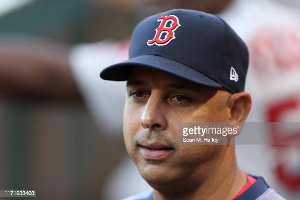 Manager Alex Cora of the Boston Red Sox looks on during a game against the Los Angeles Angels of Anaheim at Angel Stadium of Anaheim on August 31...