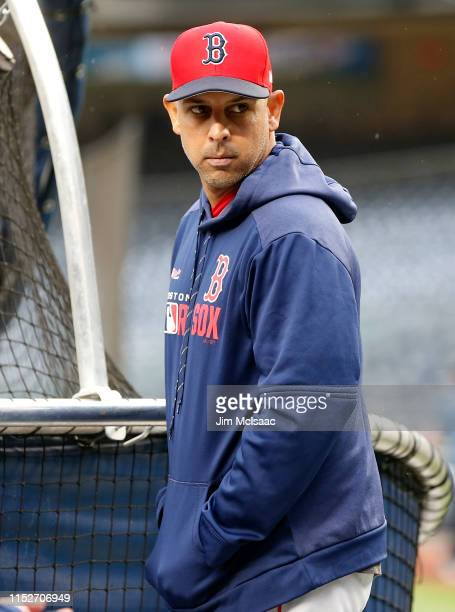 Manager Alex Cora of the Boston Red Sox looks on during batting practice before a game against the New York Yankees at Yankee Stadium on May 30, 2019...