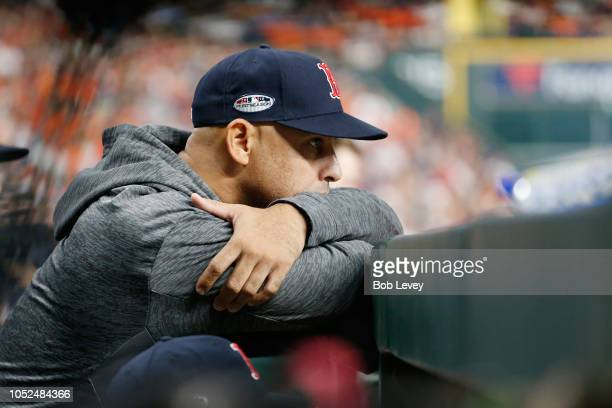 Manager Alex Cora of the Boston Red Sox looks on from the dugout during Game Five of the American League Championship Series against the Houston...