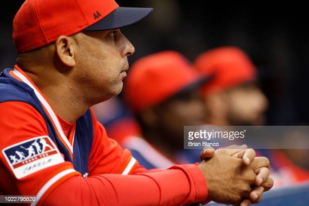 Manager Alex Cora of the Boston Red Sox looks on from the dugout during the third inning of a game against the Tampa Bay Rays on August 24 2018 at...