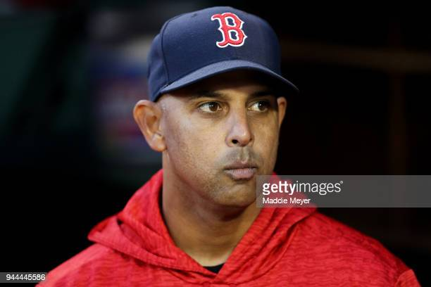 Manager Alex Cora of the Boston Red Sox looks on from the dugout before the game against the New York Yankees at Fenway Park on April 10 2018 in...