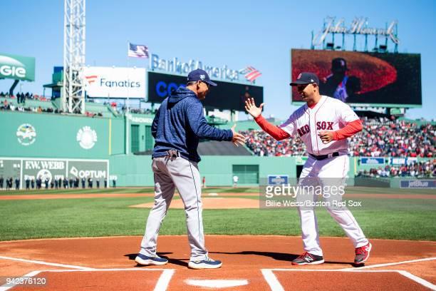 Manager Alex Cora of the Boston Red Sox shakes hands with manager Kevin Cash of the Tampa Bay Rays before the Opening Day on April 5 2018 at Fenway...