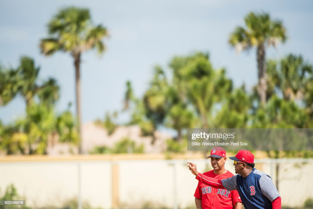 Manager Alex Cora of the Boston Red Sox speaks with former pitcher Pedro Martinez during a team workout on February 21, 2018 at jetBlue Park at Fenway South in Fort Myers, Florida .
