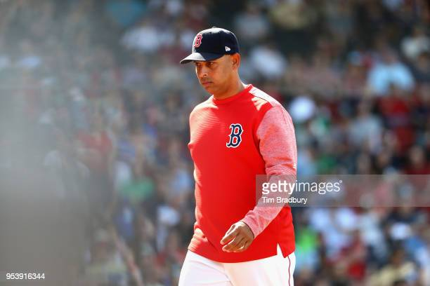 Manager Alex Cora of the Boston Red Sox walks to the dugout during the game against the Kansas City Royals at Fenway Park on May 2 2018 in Boston...