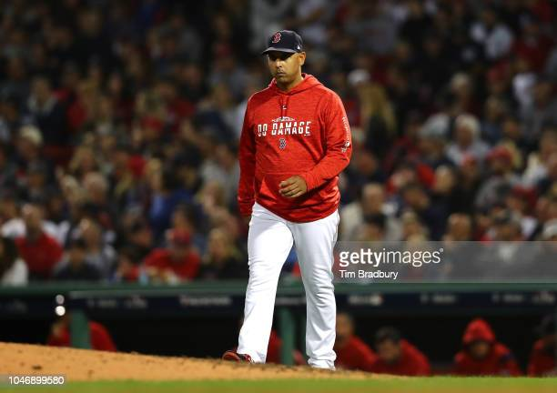Manager Alex Cora of the Boston Red Sox walks to the mound during the sixth inning of Game Two of the American League Division Series against the New...