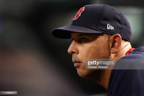 Manager Alex Cora of the Boston Red Sox watches from the dugout during the fifth inning of the MLB game against the Arizona Diamondbacks at Chase...