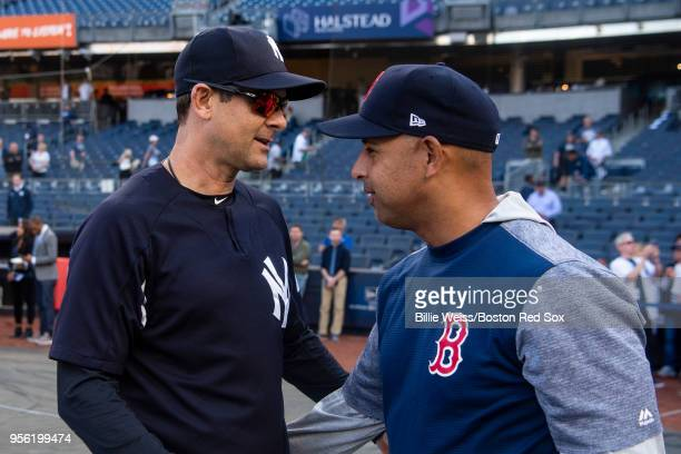 Manager Alex Cora of the Boston Red Sox withs with Manager Aaron Boone of the New York Yankees before a game on May 8 2018 at Yankee Stadium in the...