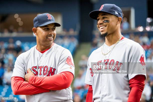 Manager Alex Cora reacts with Mookie Betts of the Boston Red Sox before the Opening Day game against the Tampa Bay Rays on March 29 2018 at Tropicana...