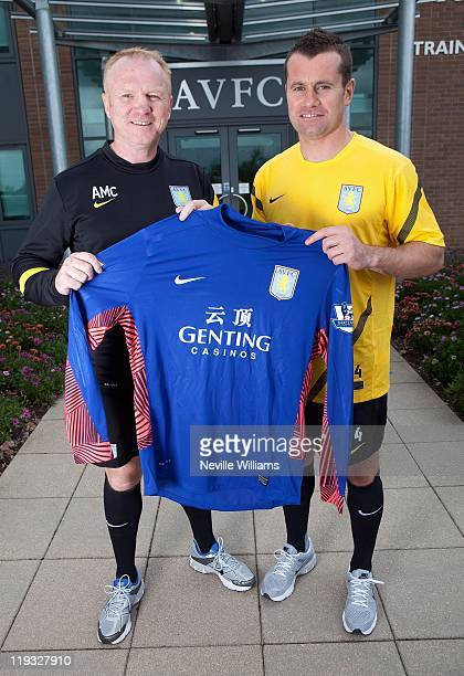 Manager Alex McCleish of Aston Villa welcomes new signing Shay Given at the Aston Villa training ground Bodymoor Heath on July 15, 2011 in...