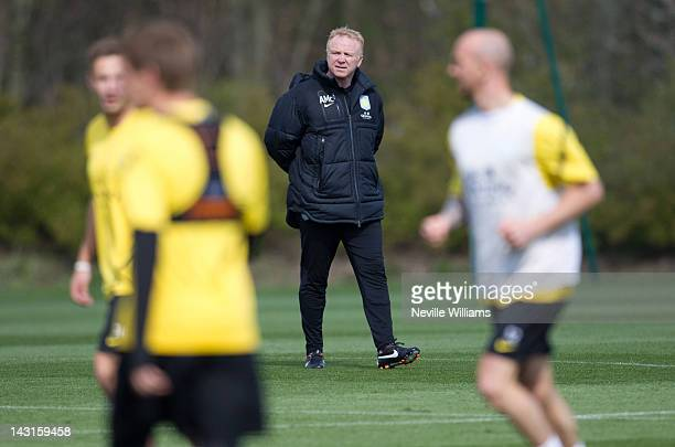 Manager Alex McLeish of Aston Villa looks on during a training session at the club's training ground at Bodymoor Heath on April 20 2012 in Birmingham...