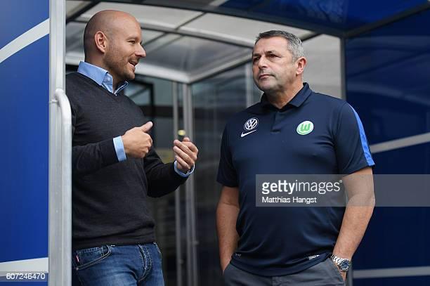 Manager Alexander Rosen of Hoffenheim talks to Manager Klaus Allofs of Wolfsburg prior to the Bundesliga match between TSG 1899 Hoffenheim and VfL...