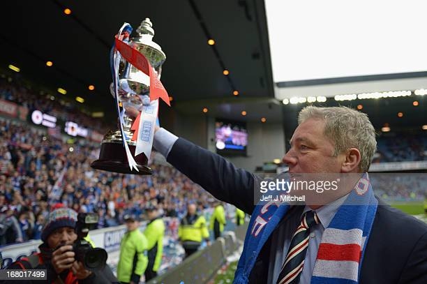 Manager Ally McCoist of Rangers holds the IRN BRU Scottish Third Division trophy as he shows fans following his team's victory over Berwick Rangers...