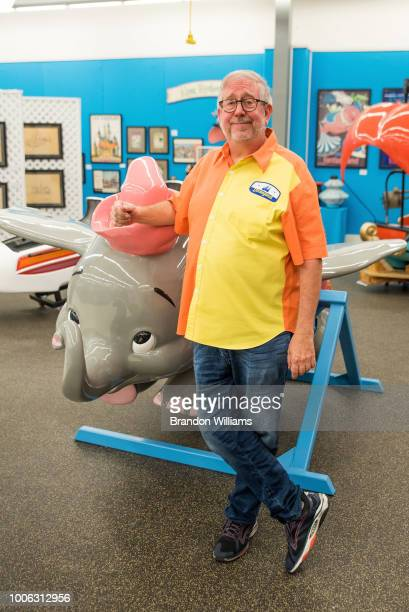 Manager and collector Richard Kraft stands in front of his collection of rare Disney memoribilia items before they're auctioned off at the That's...