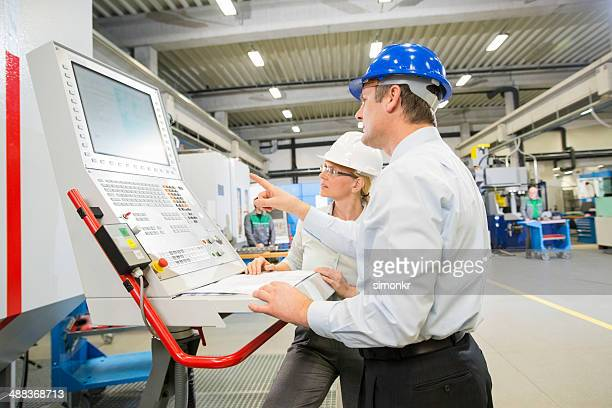 manager and engineer programming a cnc - mechatronics stock pictures, royalty-free photos & images