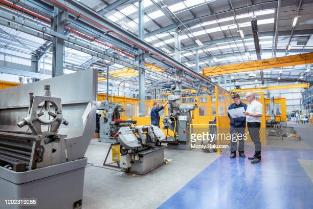manager and engineers in electrical engineering factory - manager stock pictures, royalty-free photos & images