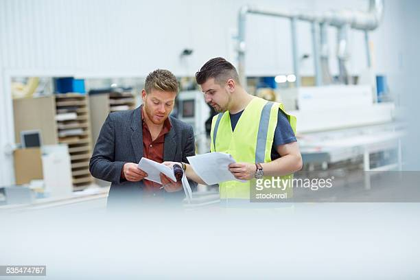 Manager and foreman going through some paperwork