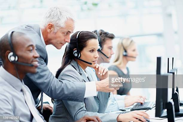Manager and his team working in a call center