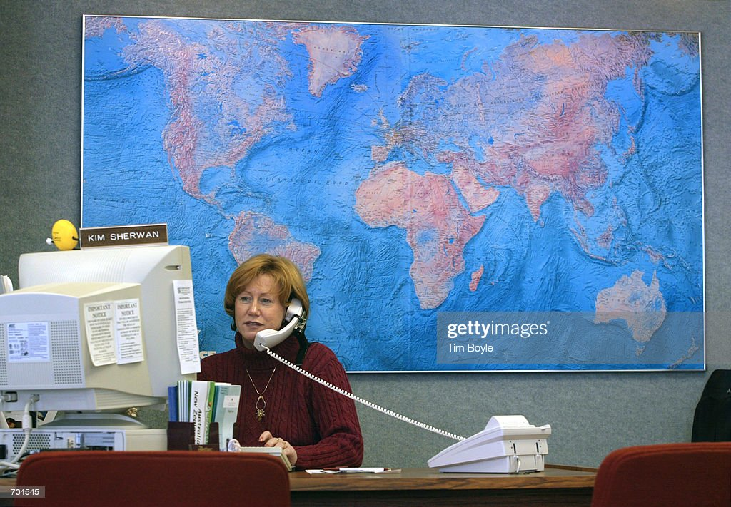 Manager and travel consultant Kim Sherwan speaks with a client on the phone while seated at her desk in front of a world map March 18, 2002 at First-Maine Travel Agency in Des Plaines, IL. Delta Air Lines became the first carrier to stop paying travel agent commissions on individual tickets sold in the U.S. and Canada, a bold step that could save it hundreds of millions of dollars annually. Delta will continue to pay commissions to large agencies that can deliver significant business to it as well as for tickets purchased outside the U.S. and Canada. Other major carriers are expected to follow Delta as they did in 1995 when Delta was the first to cut the standard 10% commission on domestic tickets.