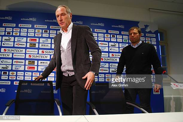 Manager Andreas Mueller and interim coach Frank Kramer of Hoffenheim arrive for a press conference following the dismissal of head coach Markus...