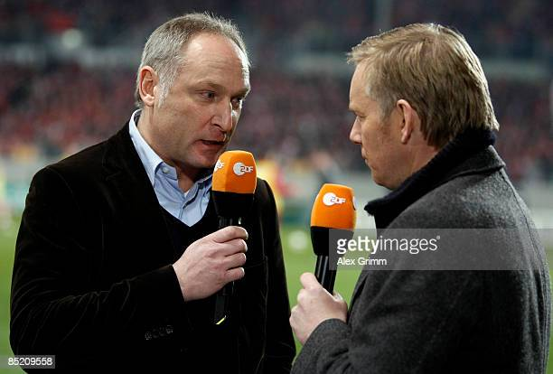 Manager Andreas Mueller talks to TV host and commentator Johannes B Kerner during an interview before the DFB Cup quarter final match between FSV...