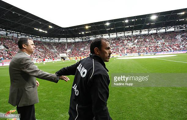 Manager Andreas Rettig and head coach Jos Luhukay of Augsburg react prior to the Bundesliga match between FC Augsburg and Hamburger SV at SGL Arena...