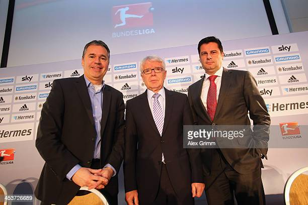 Manager Andreas Rettig, league president Reinhard Rauball and DFL executive director Christian Seifert pose after a press conference following the...