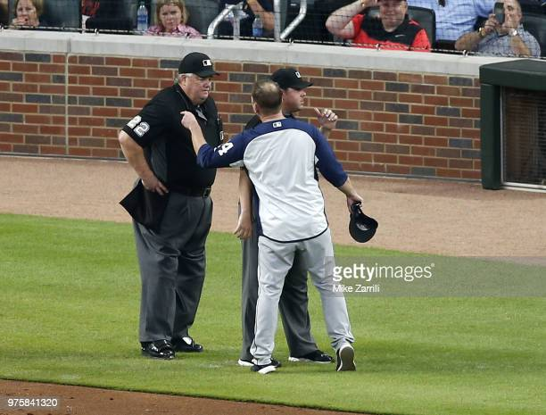 Manager Andy Green of the San Diego Padres argues with home plate umpire Joe West after being ejected in the fifth inning during the game against the...