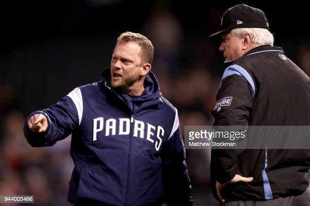 Manager Andy Green of the San Diego Padres disputes a home run call with umpire Brian Gorman in the sixth inning against the Colorado Rockies at...