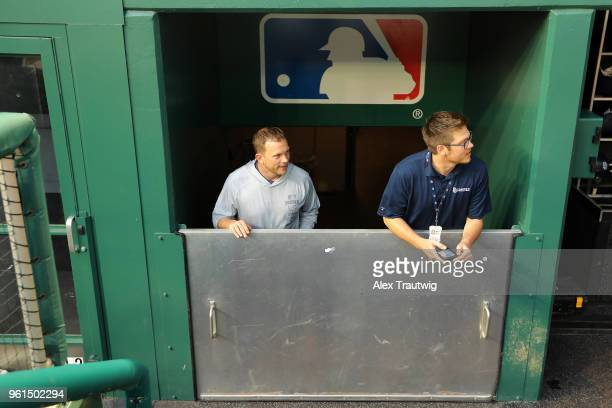 Manager Andy Green of the San Diego Padres looks on after the dugout was prepared for a severe storm ahead of a game against the Washington Nationals...