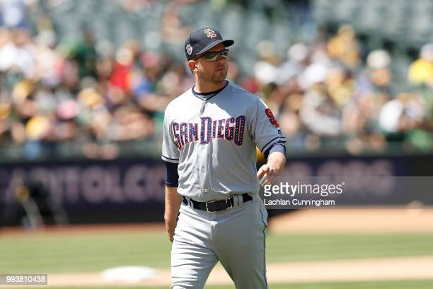 Manager Andy Green of the San Diego Padres looks on during the seventh inning for eh game against the Oakland Athletics at Oakland Alameda Coliseum...