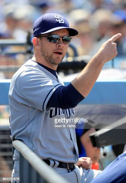 Manager Andy Green of the San Diego Padres motions from the dugout during the sixth inning of an Opening Day game against the Los Angeles Dodgers at...
