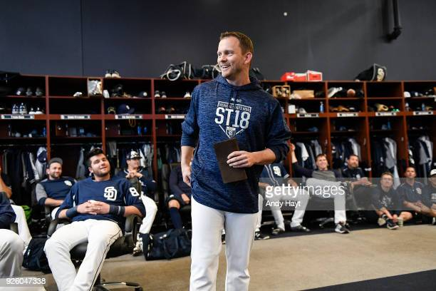 Manager Andy Green of the San Diego Padres talks to players prior to a workout at the Peoria Sports Complex on February 21 2018 in Peoria Arizona
