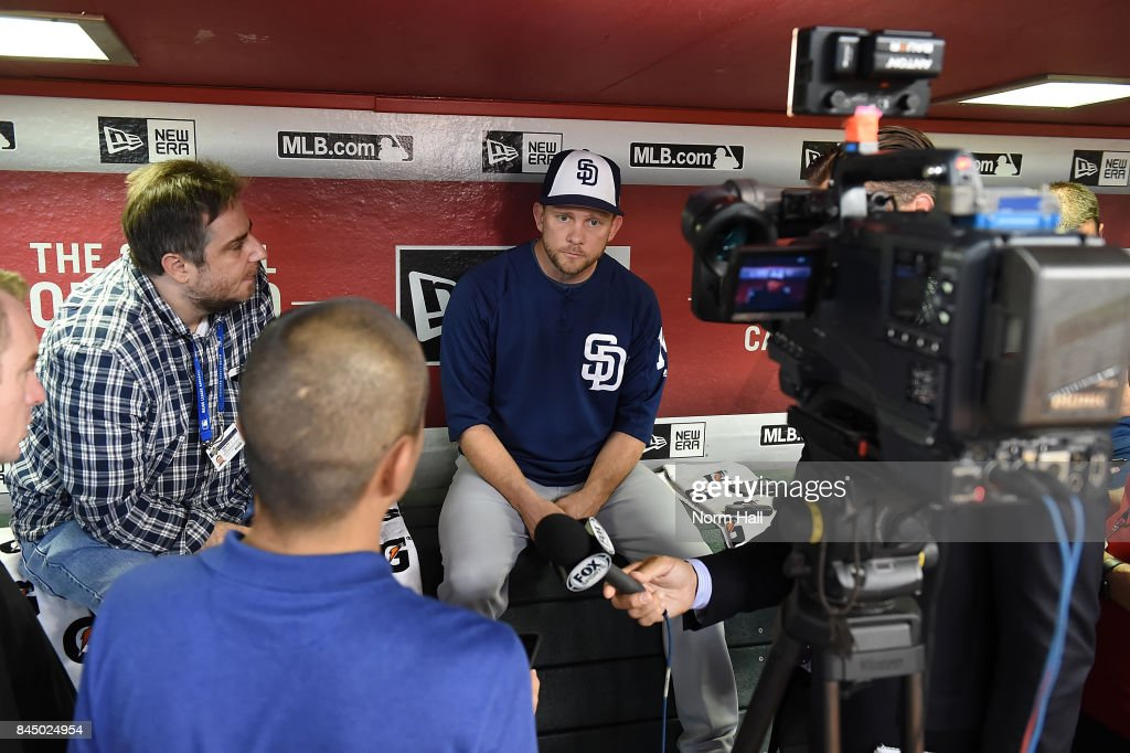Manager Andy Green #14 of the San Diego Padres talks with the media in the dugout prior to a game against the Arizona Diamondbacks at Chase Field on September 9, 2017 in Phoenix, Arizona.